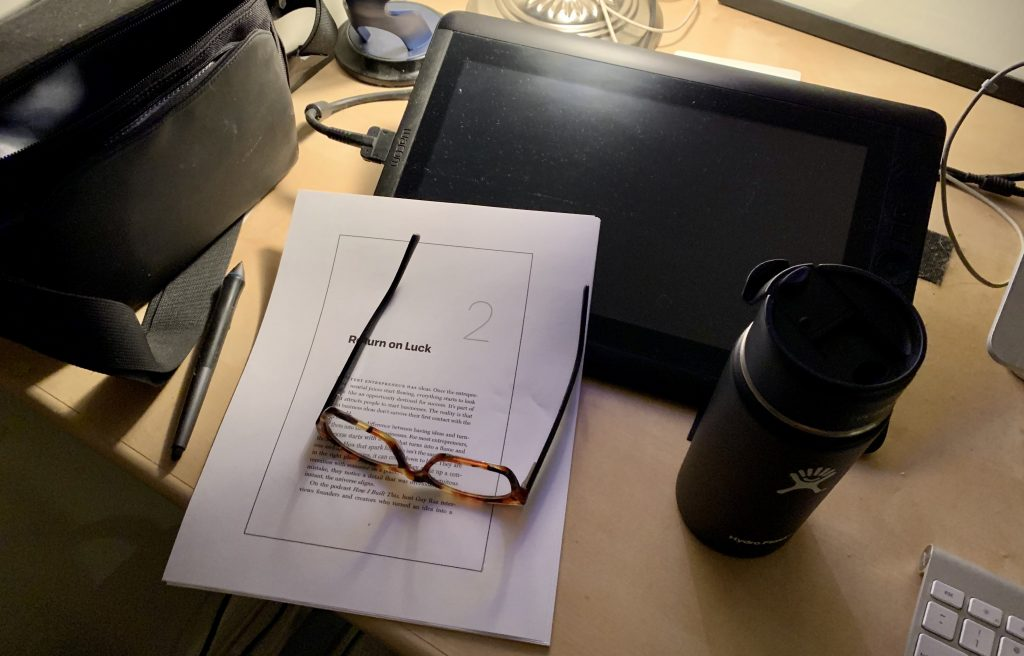 Photo of desk with glasses and book